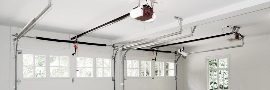How to fix a noisy garage door hill country overhead door for Noisy garage door opener motor