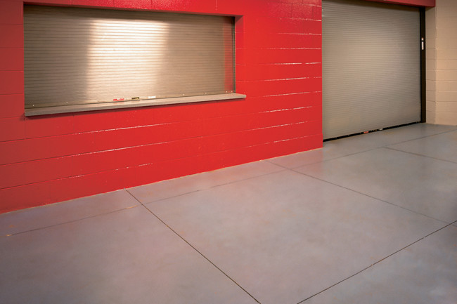 red cinder block wall with steel security windows