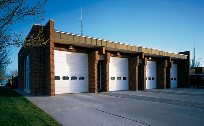 four white garage doors at a fire station