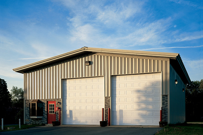 metal building with two large rolling garage doors